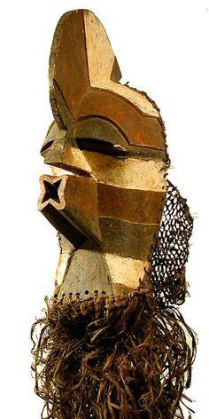 "SONGYE, D.R.Congo Mask kifwebe 41"" h with costume  Photographs © Tim Hamill"