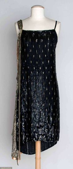 SEQUIN FLAPPER DRESS, 1920s - Straight sheath completely covered in small black sequins, inset w/ pattern of small silver dashes, silver sequin scarf on left shoulder