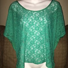 Charlotte Russe Top A beautiful green Charlotte Russe top in a xlarge it's got short sleeves with a solid green back and a sheer lace front that looks cute with any tank cami or bralette it's still in great condition from a smoke free house Charlotte Russe Tops