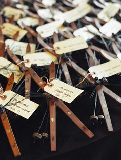 Ski ornament escort cards.  Rustic elegant wedding at The Ritz Carlton Bachelor Gulch.  Wedding featured in Town & Country Weddings.  Gemini Event Planning. www.geminieventplanning.com www.lizbanfield.com