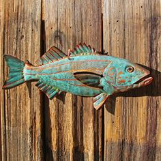 CUSTOM for you - copper fish sculpture with glass eye - repurposed - OOAK. $36.00, via Etsy.
