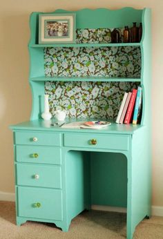 totally transformed desk with vintage wallpaper, mismatched glass drawer knobs, and pretty teal paint