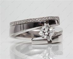 14k White Gold Pointed Tension Setting with Princess 1.02 Carat D VS1 Ideal Cut Diamond.