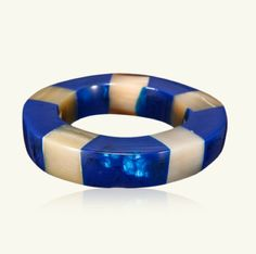 Marni - Bracelet in resin of average width. Rigid. Inlays in contrasting color horn.