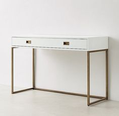 RH TEEN's Avalon Desk:The sleek lines of our collection capture the sophisticated restraint of modernism, while its polished cast-metal fittings – including recessed pulls and a metal base – take it in a new direction.