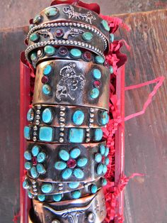 Mad cow company cuff bracelets...I love the team roper and turquoise on top!