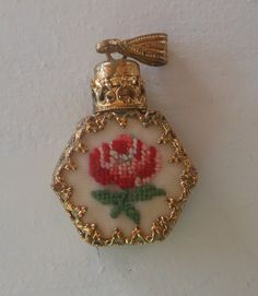 Small glass perfume bottle pendant with petit point by Cornsant