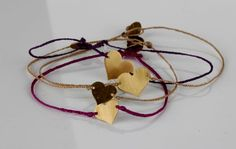 Multiple brass hand cut 'maxi and mini heart' charm on silk with brass clasp.    R170 each