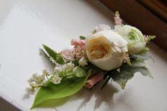 Our Bride Groom's spectacular Boutonniere of fresh Lily of the Valley, Ranuncula, Astilbe, individually rolled Rose Petals and an English Garden Rose