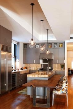 Modern Kitchen with European Cabinets, L-shaped, Maple cinnamon solid hardwood flooring, Pendant light, Wood counters, Flush