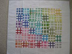 Pound Quilt....like the use of white in the design...imagine this one with a gradient use of darker colors radiating from the center out....darks for the 'pound sign'...moving from grays to white at the edges...