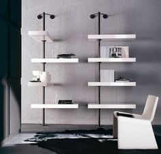 Colzani (metal column is fixed to the wall with a thick oak shelf)