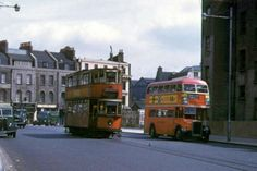 Tram on route 40 in Lambeth Palace Road passes an RTL bus on route to Camden Town, 15 June