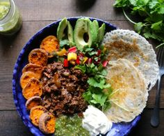 These Sloppy Jane Tex Mex Bowls are loaded with chipotle molasses infused beef, crispy paleo flatbreads,caramelized yams,fresh salsa verde and veggies YUM