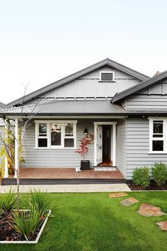 A pair of serial renovators transformed this Geelong bungalow Finding timeworn homes and treating them like 'old friends' is a way of life for a pair of serial renovators. In this Californian-style bungalow in Victoria, the dynamic duo lovingly refre Bungalow Exterior, Bungalow Renovation, Cottage Exterior, House Renovations, 1930s House Exterior, Colonial Exterior, House Remodeling, Weatherboard Exterior, Grey Exterior