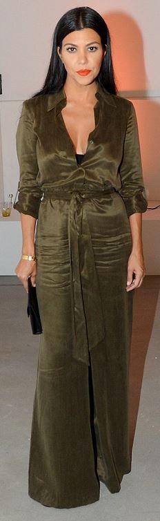 Who made  Kourtney Kardashian's gold jewelry, black clutch handbag, and green jumpsuit?