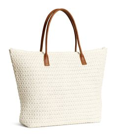 Pack all of your beach essentials in this soft white straw tote with faux leather handles & inner compartments. | H&M Swim