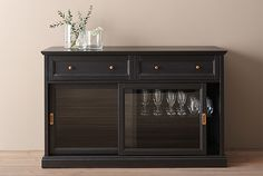 MALSJÖ is a traditional glass-door sideboard that can show off, as well as protect, your glassware and favorite collections. The black stained surface, brass knobs and handles and overall attention to detail, gives it a distinct character.