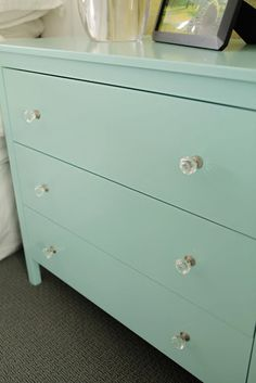 hemnes makeover: painted benjamin moore's 'artic blue' with added crystal knobs.