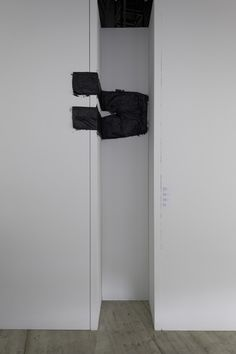 <h5>Ohne Titel (V)</h5>,2011, trousers, bitumen paint, Size 31/33, 120 x 45 cm