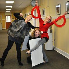 Halloween costumes for a trio: rock, paper, scissors.