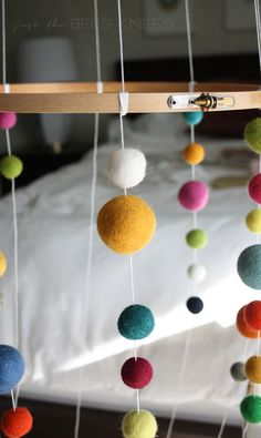 Last December, we were blessed with a new addition to our family! My sister gave birth to sweet baby boy, and my boys were over the moon to FINALLY have a first cousin. I knew I wanted to make something special for his nursery, so when my sister mentioned a felt ball mobile she saw and really