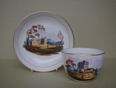 ENGLISH TEACUP AND SAUCER WITH PAINTED SCOTTISH SCENES c1820