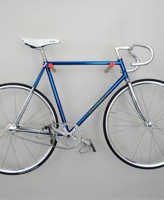 wooden bike hook, minimal and simple. via Etsy.