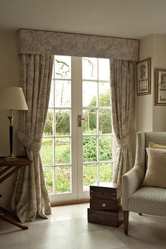 Pencil Pleat Curtains with Pelmet - A tape heading that is popular as it offers a neat finish without being too formal, suits all fabric types and can go on a pole or track, with our without a pelmet. Our photo features a matching pelmet and set of tie-backs with contrast piping.