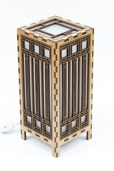 This lantern was inspired by Frank Lloyd Wright's mission style stained glass windows. The lantern was laser cut from .25 inch (3mm) solid Alder.