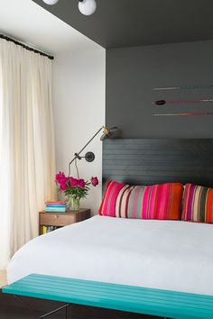 You'll Covet This Color-Soaked Brooklyn Apartment  #refinery29  http://www.refinery29.com/dwell/1#slide7  The bed in the master bedroom is a custom JHID design in ebony-stained fir. Lighting is kept subtle, in the form of an overhead fixture by Schoolhouse Electric and wall sconces by Workstead. The arrows are by Fredericks and Mae. NEXT: Brooklyn Home Makeovers You Won't Believe