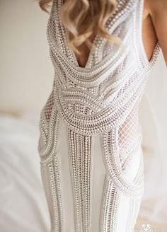 How amazing is this halter wedding dress completely made up of pearls