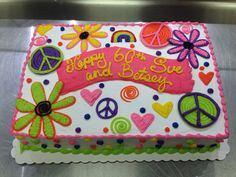 Flower and peace signs neon hippie cake