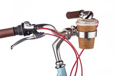 Bicycle handlebar coffee cup carrier. I don't need it at all, but come on. That's awesome.