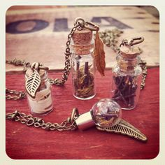 Mini terrarium necklaces by Cinder & Sage! Filled with moss, twigs, birch bark and/or stones.