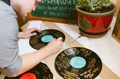 Vinyl record wedding guestbook - they'll look great framed! via @artfullywed