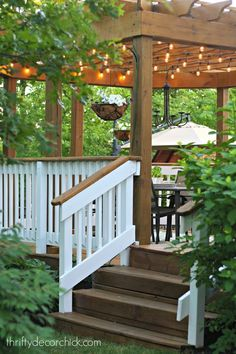 Gorgeous deck with pergola, lights and white railings...love!  Thrifty Decor Chick blog