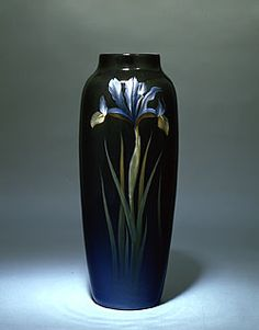 "Carl Schmidt Rookwood Pottery Cincinnati, Ohio Vase with decoration of irises and ""black iris"" glaze, 1909 Thrown white earthenware with underglaze slip decoration Newark Art Museum Collection Rookwood Pottery, Pottery Vase, Ceramic Pottery, Pottery Painting Designs, Pottery Designs, Le Far West, Objet D'art, Arts And Crafts Movement, Ceramic Clay"