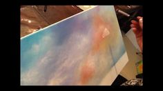 Learn to paint simple cloud shapes using a wet in wet technique using acrylic paints. Join Gaby Hunter for other painting techniques and online art classes a...