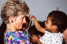 Diana beamed as a child toyed with her royal gems during a visit to a hostel for HIV-positive and abandoned children in Sao Paolo, Brazil, in 1991.