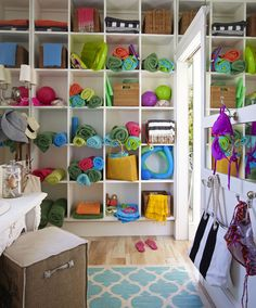 beach towel cubbies along with bright flip flops and pool toys - summer fun!