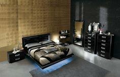 cama negra iluminada moderna con cómoda