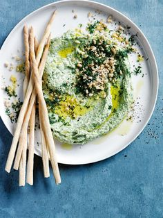 spinach, feta and dill hummus with pine nuts