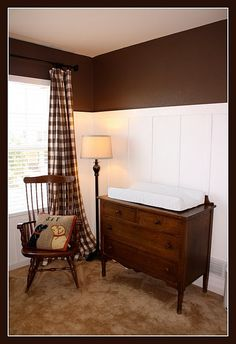 Board and batten walls, love the dark chocolate and plaid curtains with it!