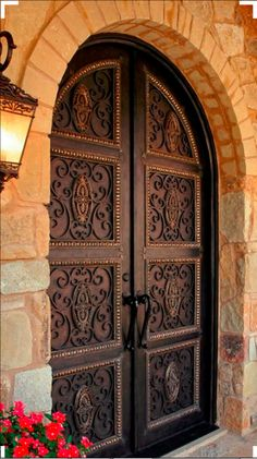 Meet this gorgeous brass and rose copper color wrought iron door that makes this house inviting. Contact us today to get that warm welcome each and every time you walk through your front door.