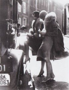 1920's ladies getting in a taxi--is this Russia?