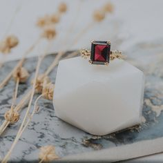 Part of the Timeless & Bespoke collection, the gorgeous deep red wine coloured Morwenna ring draws inspiration from nature and organic forms. This timeless beautiful ring has been created by casting oats, quinoa and poppy seeds in solid 9ct yellow gold with added granulated detail to create the perfect setting for the 10x8mm deep red Mozambique garnet stone. #recycledsilver #daintylondon #ilovejewellery #jewelleryqueen #wintergifts #handmadegifts #womeninbusiness #dressinghappy… Gold Jewellery, Silver Jewelry, Garnet Stone, Organic Form, Natural Forms, Stone Rings, Vintage Rings, Beautiful Rings, Diamond Rings