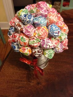 Lollipop guild inspired bouquet. Wizard of Oz party...could be a prize for guessing game?