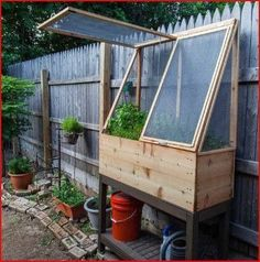 Wooden cold frame with garden potting bench
