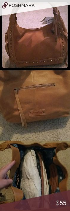 Lucky Brand Purse Cognac colored genuine leather, never used.  Tags in place. Lucky Brand Bags Hobos